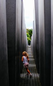 girl plays in concrete structure 2